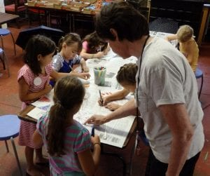 Vanderbilt educator works with children in a creative workshop Vanderbilt Museum photo